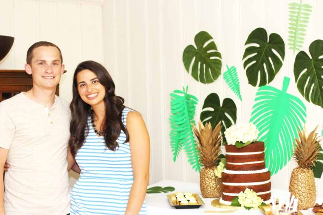 Bride and groom with the hawaiian-inspired dessert table