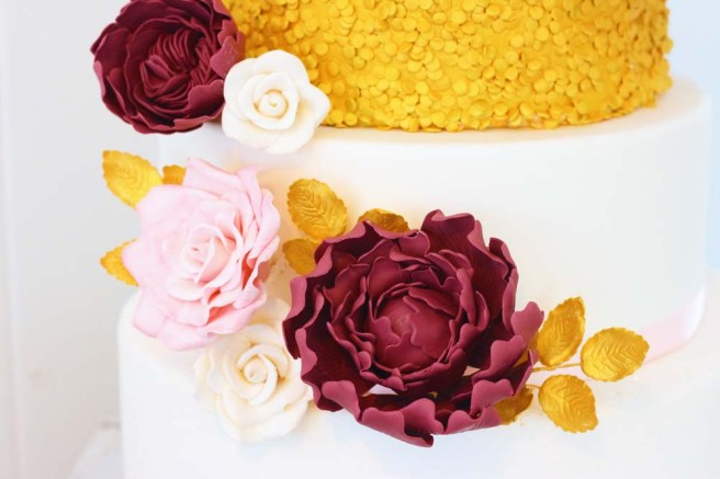 close up of sugar flowers on wedding cake by cafe pierrot in sparta nj