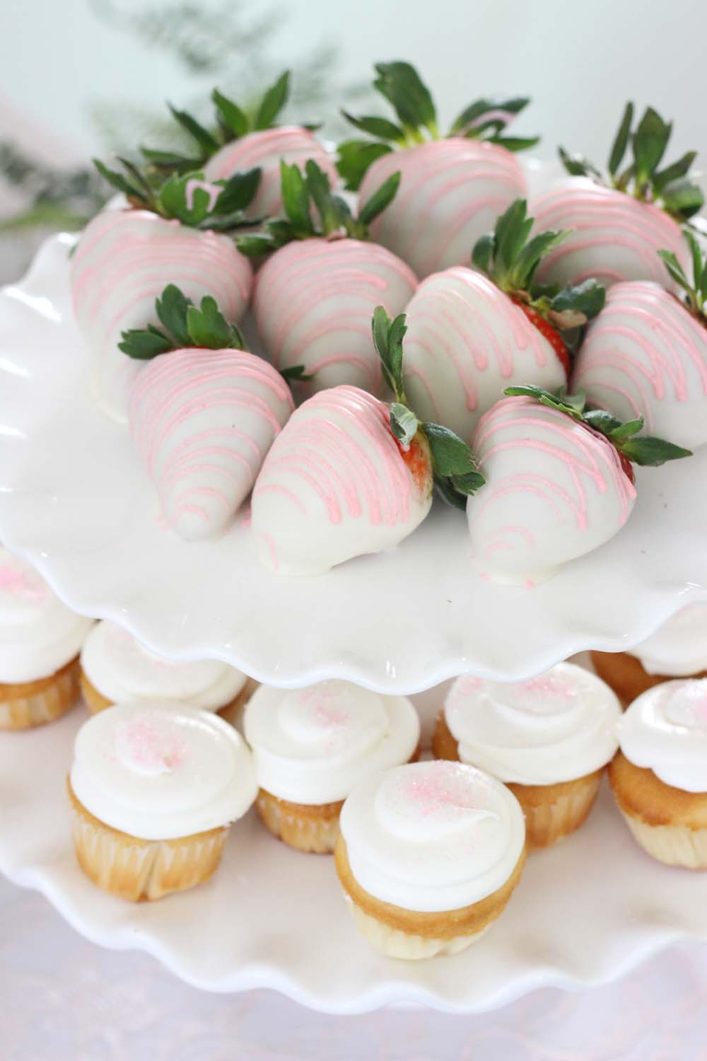 Tiered mini cupcakes and chocolate covered strawberries for a wedding dessert table from Cafe PIerrot in Sparta NJ